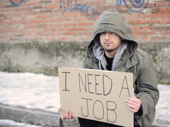 unemployed-man-with-sign.jpg