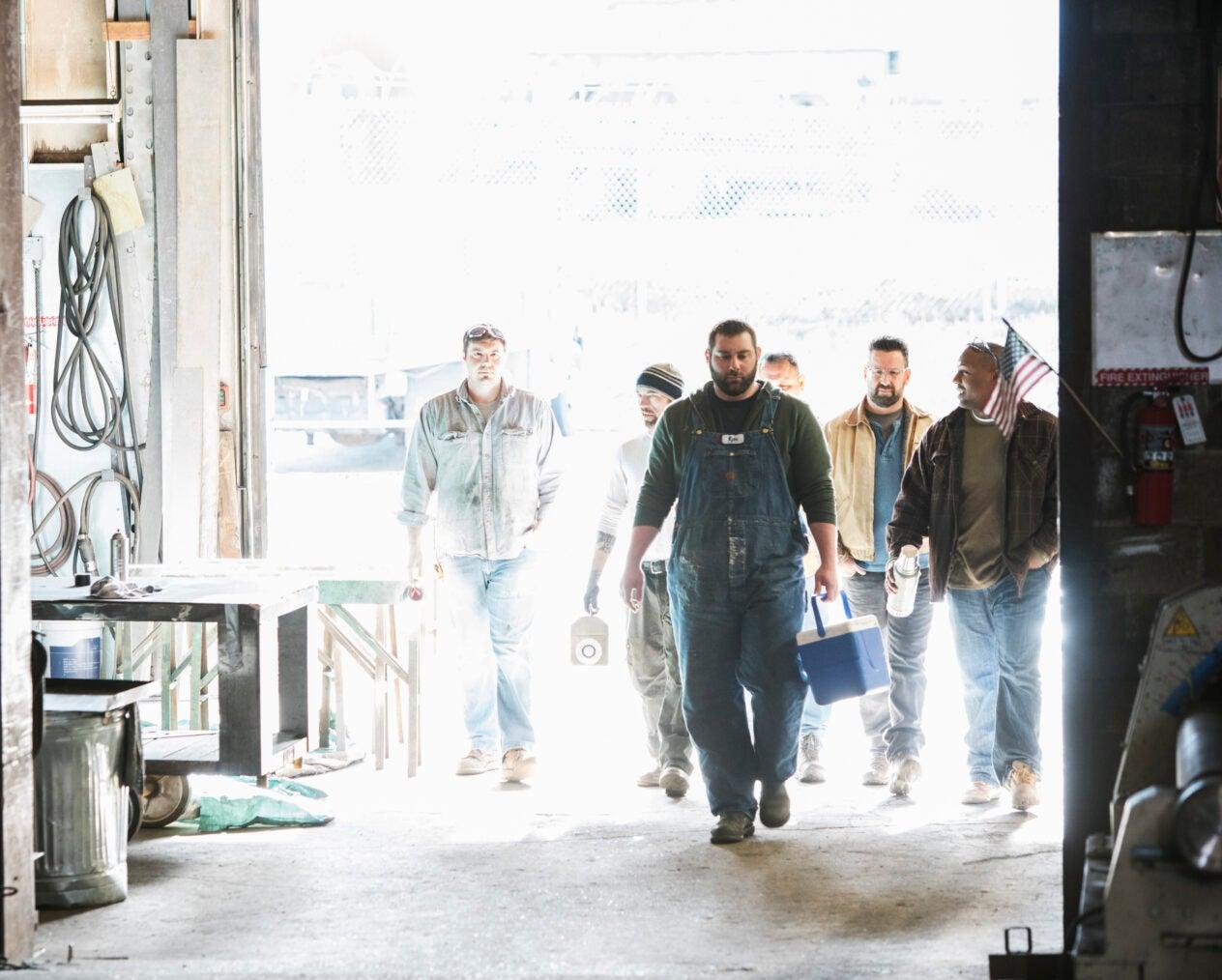 Workers entering door of workshop